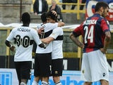 Parma's Raffaele Palladino celebrates with team mates after scoring the equaliser against Bologna during the Serie A match on April 13, 2014