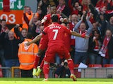 Raheem Sterling of Liverpool celebrates his early goal against Manchester City with teammate Luis Suarez at Anfield on April 13, 2014