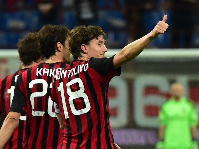 AC Milan's midfielder Riccardo Montolivo (C) celebrates with teammates after scoring a goal during the Serie A football match between AC Milan and Catania at San Siro stadium in Milan on April 13, 2014