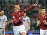Roma's Rodriguo Taddei celebrates after scoring the opening goal against Atalanta during the Serie A match on April 12, 2014