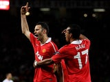 Manchester United's Ryan Giggs celebrates with teammate Nani after scoring his team's first goal against Chelsea during the Champions League quarter final match on April 12, 2011