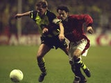Manchester United's Ryan Giggs battles for possession against Borussia Dortmund on April 09, 1997.