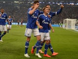 Schalke's midfielder Max Meyer, Schalke's midfielder Leon Goretzka and Schalke's defender Sead Kolasinac celebrate during the German first division Bundesliga football match FC Schalke 04 vs Eintracht Frankfurt in Gelsenkirchen, western Germany on April 1
