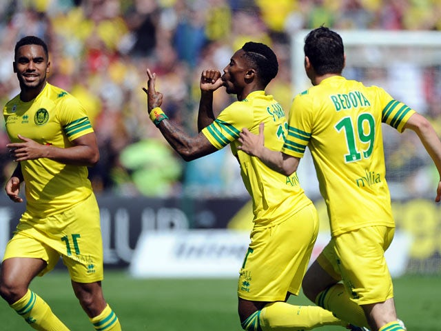 Nantes' Serge Gakpe celebrates after scoring the opening goal against Guingamp during the Ligue 1 match on April 13, 2014