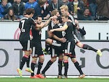 Leverkusen's Stefan Kiessling celebrates with team mates after scoring the opening goal against Hertha Berlin during the Bundesliga match on April 13, 2014