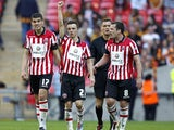 Sheffield United's Stefan Scougall celebrates after scoring his team's second goal against Hull during the FA Cup semi final match on April 13, 2014