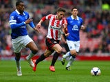 Fabio Borini of Sunderland and Sylvain Distin of Everton compete for the ball during the Barclays Premier League match between Sunderland and Everton at Stadium of Light on April 12, 2014