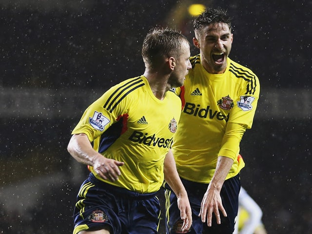 Lee Cattermole of Sunderland celebrates scoring the opening goal with Fabio Borini of Sunderland during the Barclays Premier League match between Tottenham Hotspur and Sunderland at White Hart Lane on April 7, 2014