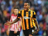 Hull's Tom Huddlestone celebrates after scoring his team's third goal against Sheffield United during the FA Cup semi final match on April 13, 2014