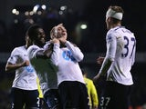 Christian Eriksen of Tottenham Hotspur celebrates scoring his team's third goal with Emmanuel Adebayor of Tottenham Hotspur during the Barclays Premier League match between Tottenham Hotspur and Sunderland at White Hart Lane on April 7, 2014