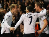 Harry Kane of Tottenham Hotspur celebrates scoring his team's second goal with Christian Eriksen and Aaron Lennon during the Barclays Premier League match between Tottenham Hotspur and Sunderland at White Hart Lane on April 7, 2014