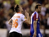 Valencia's forward Paco Alcacer celebrates his goal during the UEFA Europa League quarterfinal second leg football match Valencia CF vs FC Basel at the Mestalla stadium in Valencia on April 10, 2014