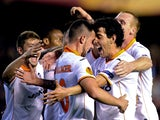 Valencia's forward Paco Alcacer celebrates his goal with teammates during the UEFA Europa League quarterfinal second leg football match Valencia CF vs FC Basel at the Mestalla stadium in Valencia on April 10, 2014