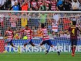 Granada's Yacine Brahimi celebrates after scoring the opening goal against Barcelona during the La Liga match on April 12, 2014