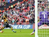 Hull's Yannick Sagbo scores his team's first goal against Sheffield United during the FA Cup semi final match on April 13, 2014
