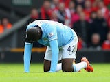 Manchester City midfielder Yaya Toure kneels down in pain after injuring himself during the Premier League match against Liverpool on April 13, 2014