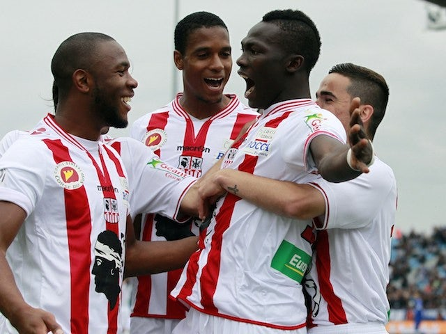 Ajaccio's Guinean forward Aboudacar Camara (C) is congratulated by teammates after scoring a goal during the French L1 football match between Bastia (SCB) and Ajaccio (ACA) on April 20, 2014