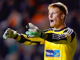 Adam Bogdan of Bolton in action during the Sky Bet Championship match between Blackpool and Bolton Wanderers at Bloomfield Road on October 01, 2013