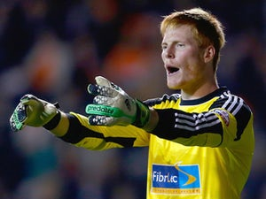 Adam Bogdan completes Wigan loan move