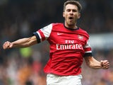 Aaron Ramsey of Arsenal celebrates scoring his sides first goal during the Barclays Premier League match between Hull City and Arsenal at KC Stadium on April 20, 2014