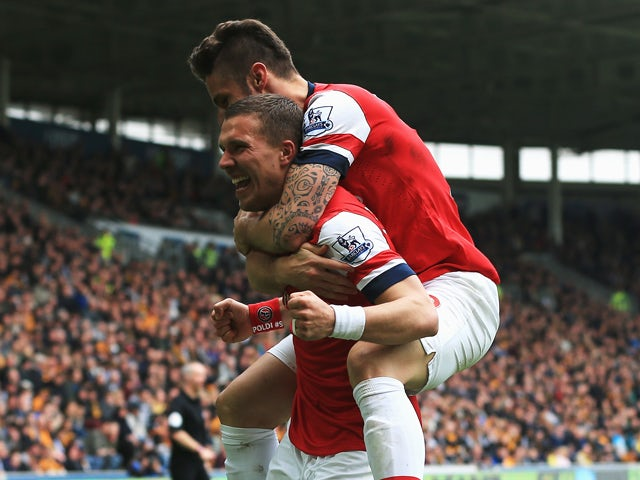 Result: Podolski double eases Arsenal to Hull win