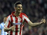 Athletic Bilbao's forward Aritz Aduriz celebrates after scoring during the Spanish league football match Athletic Club Bilbao vs Malaga CF at the San Mames stadium in Bilbao on April 14, 2014