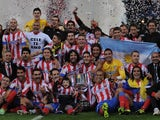 Atletico Madrid players celebrate winning the Copa del Rey against Real Madrid on May 17, 2013.
