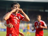 Bayern Munich's Peruian striker Claudio Pizarro celebrates after scoring during the German first division Bundesliga football match Eintracht Braunschweig vs FC Bayern Munich in Braunschweig, central Germany, on April 19, 2014