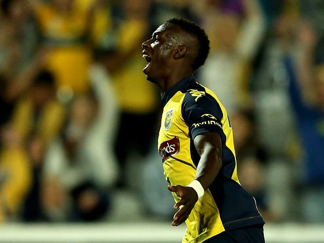 Mariners'Bernie Ibini celebrates after scoring the opening goal against Adelaide during the A-League Elimination Final match on April 19, 2014