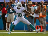 Brandon Gibson #10 of the Miami Dolphins reacts to a first down during a game against the Atlanta Falcons on September 22, 2013