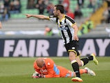 Udinese's Bruno Fernandes celebrates after scoring his team's first goal against Napoli during the Serie A match on April 19, 2014