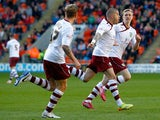 Michael Kightly of Burnley celebrates his goal with team mates during the Sky Bet Championship match between Blackpool and Burnley at Bloomfield Road on April 18, 2014