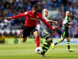 Fraizer Campbell of Cardiff City evades Glenn Whelan of Stoke City during the Barclays Premier League match between Cardiff City and Stoke City at Cardiff City Stadium on April 19, 2014