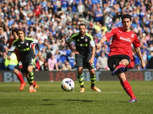 Peter Whittingham of Cardiff City scores their first goal from a penalty kick during the Barclays Premier League match between Cardiff City and Stoke City at Cardiff City Stadium on April 19, 2014