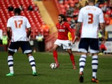 Diego Poyet of Charlton looks to keep play moving during the Sky Bet Championship match between Charlton Athletic and Bolton Wanderers at The Valley on April 18, 2014