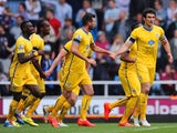 Mile Jedinak of Crystal Palace celebrates with team mates after scoring the first goal from the penalty spot during the Barclays Premier League match between West Ham United and Crystal Palace at Boleyn Ground on April 19, 2014