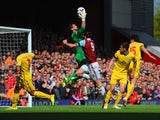 Julian Speroni of Crystal Palace makes a save from Andy Carroll of West Ham during the Barclays Premier League match between West Ham United and Crystal Palace at Boleyn Ground on April 19, 2014