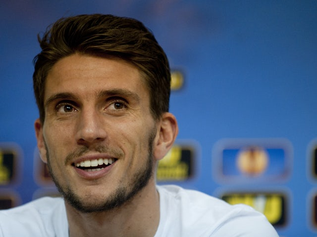 Sevilla's Portuguese defender Daniel Carrico smiles during a press conference at Ramon Sanchez Pizjuan stadium in Sevilla on April 9, 2014