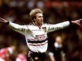 David Beckham, then of Manchester United, celebrates scoring against Arsenal on April 14, 1999.