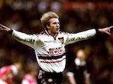 David Beckham, then of Manchester United, celebrates scoring against Arsenal on April 14, 1999.