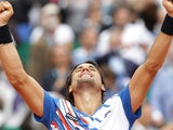 Spain's David Ferrer reacts after winning his Monte-Carlo ATP Masters Series Tournament tennis match against Spain's Rafael Nadal on April 18, 2014