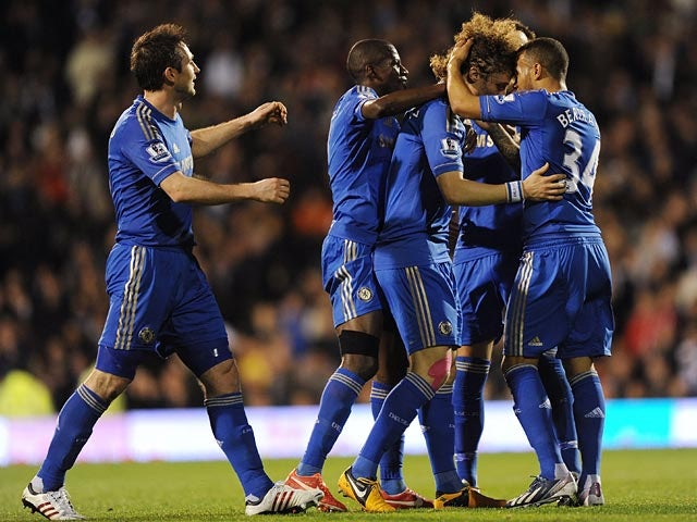 Chelsea's David Luiz celebrates with team mates after scoring the opening goal against Fulham during the Premier League match on April 17, 2013