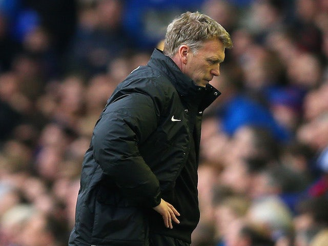 A dejected David Moyes manager of Manchester United looks to the ground during the Barclays Premier League match between Everton and Manchester United on April 20, 2014
