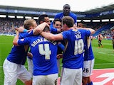 Leicester's David Nugent is congratulated by teammates after scoring the opening goal against QPR during their Championship match on April 19, 2014