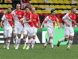 Monaco's Dimitar Berbatov celebrates with teammates after scoring the opening goal against Nice during the Ligue 1 match on April 20, 2014