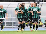 Sassuolo's Domenico Berardi is congratulated by teammates after scoring the opening goal against Chievo Verona during the Serie A match on April 19, 2014