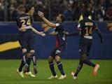 Paris' Uruguayan forward Edinson Cavani (2nd R) celebrates with teammates after a goal against Lyon on April 19, 2014