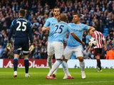Manchester City's Fernandinho celebrates with team mates after scoring the opening goal against Sunderland during the Premier League match on April 16, 2014