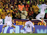 Gareth Bale of Real Madrid reacts after scoring Real's 2nd goal during the opa del Rey Final between Real Madrid and Barcelona at Estadio Mestalla on April 16, 2014