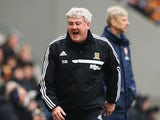Hull City manager Steve Bruce reacts on the touchline during the Barclays Premier League match between Hull City and Arsenal at KC Stadium on April 20, 2014